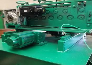 钢格板带钢校平冲孔切断一体机图片