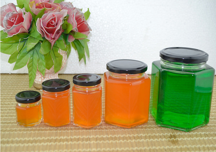厂家批发蜂蜜包装罐头瓶玻璃瓶晶白料亚克力盖饮料瓶120ML150ML300ML来样来图定制