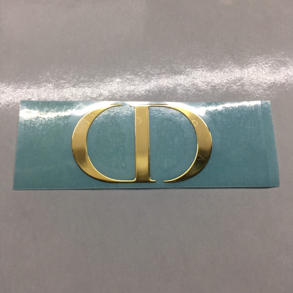 皮革热熔胶金属唛头深圳厂家专业生产电镀热压金属镍片字母唛头标贴
