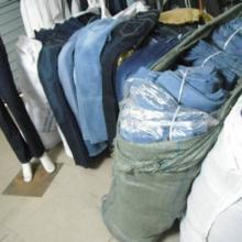 东莞库存服装回收公司回收布料库存衣服批发